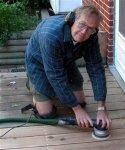 Deck building 23 -Frank using kneepads when sanding the deck -small.JPG