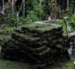 Deck building 32 -Pile of turfs -reminds me of L'Anse-aux-Meadows -small.JPG