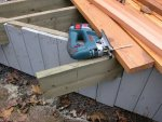 Deck building 45 -Cutting off a joist at an angle -small.JPG
