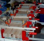 Woodworking bench 07 -clamped boards for half the bench top -small.JPG