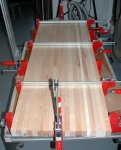 Woodworking bench 10 -the two bench top segments glued together and clamped -small.JPG